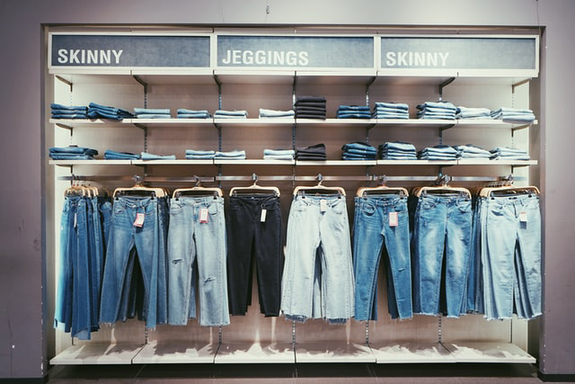 Variety of Jeans Hanging in a Store